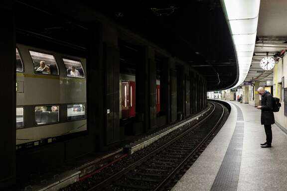 A man waits on an empty train platform at the Central Station in Brussels on Wednesday, March 23, 2016. Belgian authorities were searching Wednesday for a top suspect in the country's deadliest attacks in decades, as the European Union's capital awoke under guard and with limited public transport after 34 were killed in bombings on the Brussels airport and a subway station.