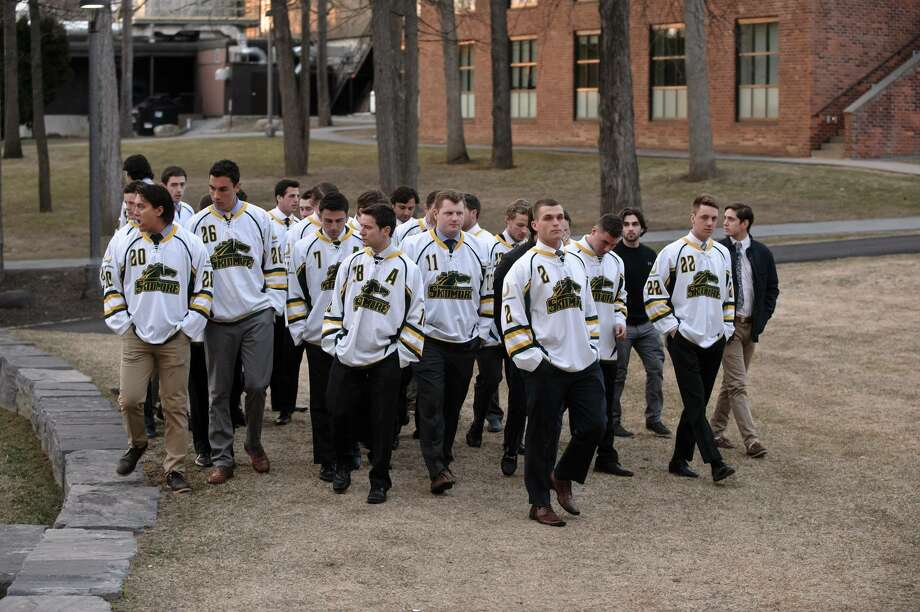 Skidmore hockey teammates walk to a campus gathering at Zankel Music Center on Tuesday, March 22, 2016, to celebrate the life of Willem Golden, a member of the hockey and lacrosse teams who died over the weekend. (Photo by Skidmore College) / Eric Jenks 2016