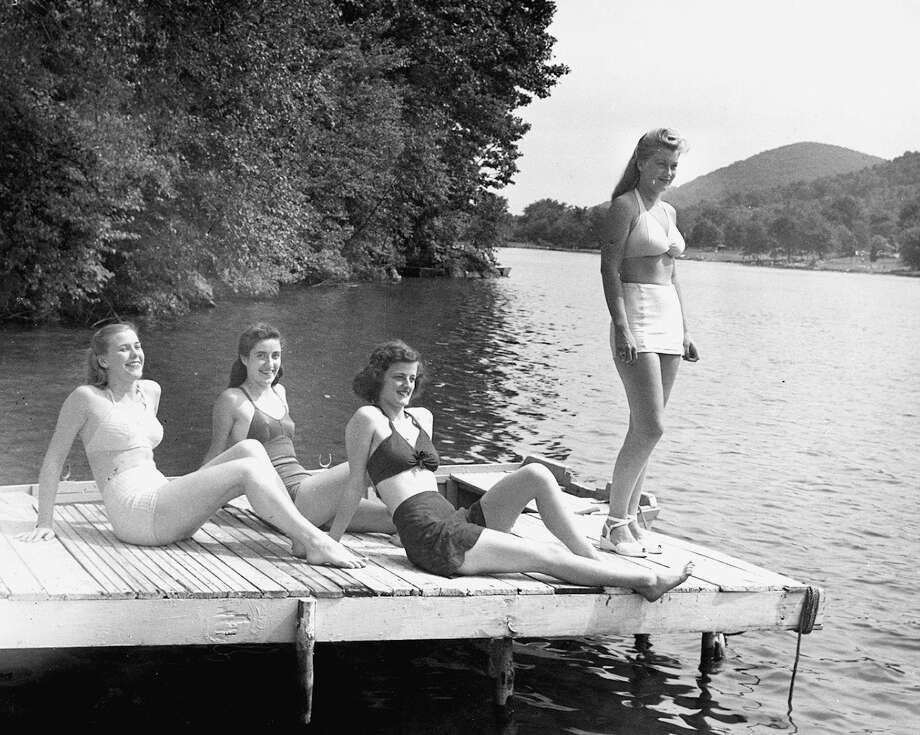 Bathing beauties enjoy a day on Candlewood Lake c. 1948. This photograph was taken on the dock of Joyceland, in New Fairfield.