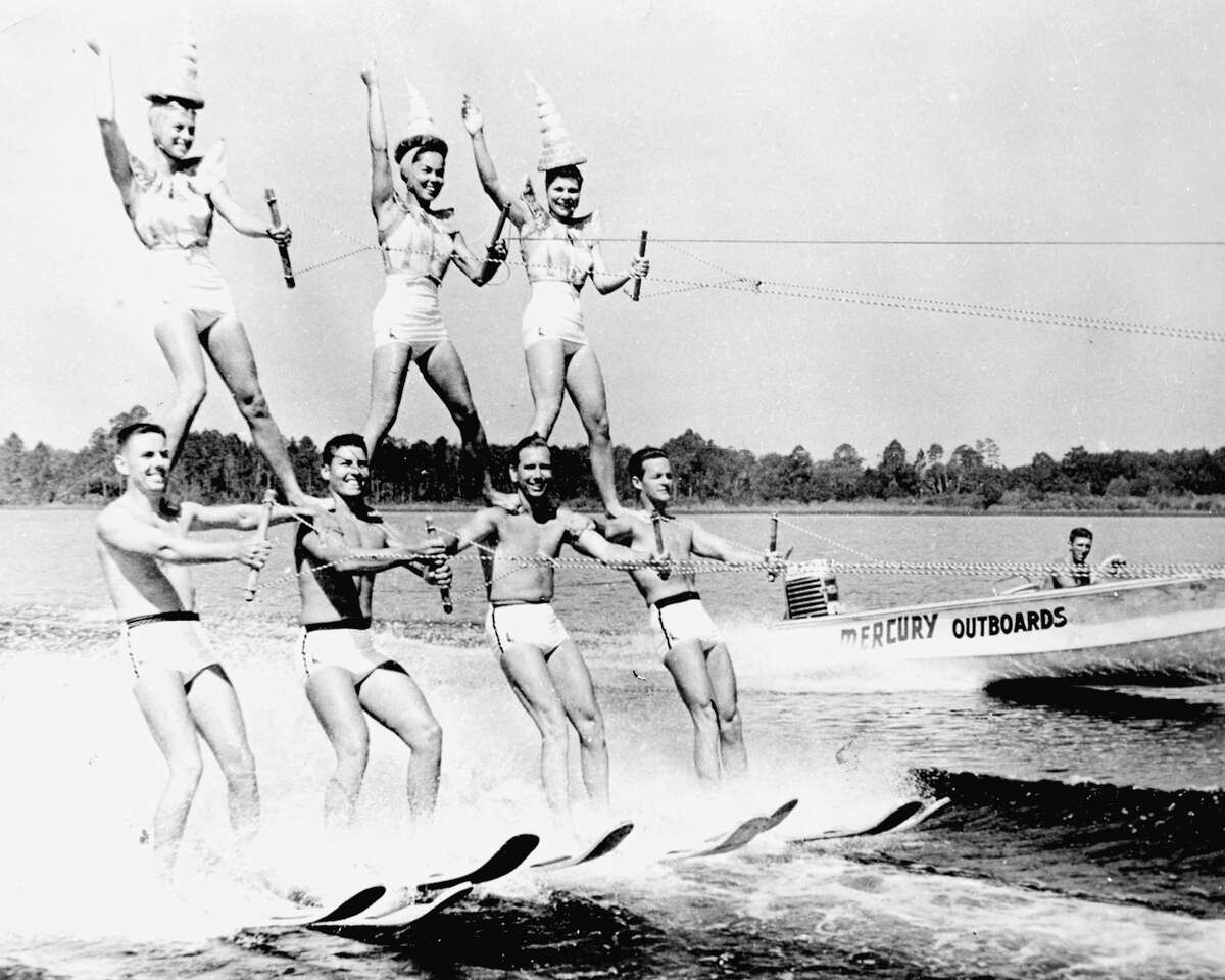 Believe it or not, these water-skiers are performing on Candlewood Lake-not Cypress Gardens. The outboard motor and the bathing suits date this photograph. This photograph was taken on the beach at Candlewood Shores during the 1960s. Reprinted with permission from Candlewood Lake, by Susan Murphy and Gary Smolen. Available from the publisher online at www.arcadiapublishing.com or by calling 888-313-2665.