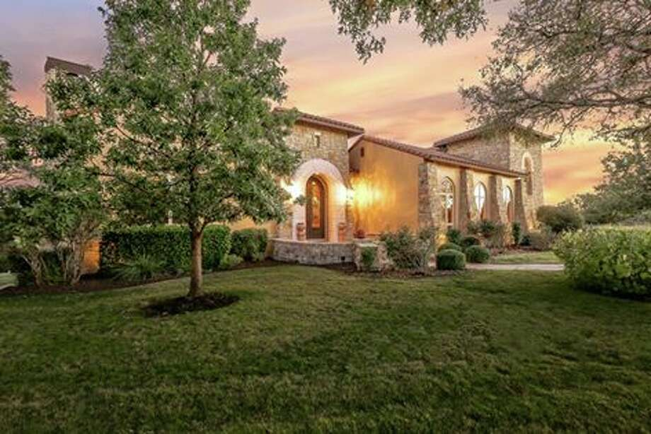 This four-bedroom Boerne mansion has a basketball court, a pool/spa and a master suite to die for. Photo: Courtesy/Lauren Keller
