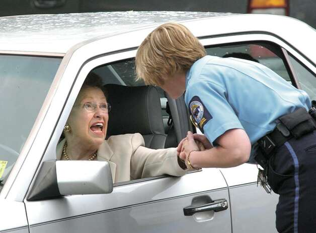 Dorthy Moxley, right, shakes hands with a law officer just before driving away from Superior Court in Norwalk for the final time after Michael Skakel was found quilty of the murder of Moxley's daughter, Martha Moxley 27 years ago in Greenwich. Photo: File Photo / Stamford Advocate File Photo