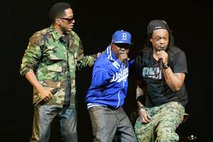 NEW YORK, NY - NOVEMBER 20: (L-R)Q-Tip, Phife Dawg and Jarobi White of A Tribe Called Quest perform  at Barclays Center on November 20, 2013 in New York City.