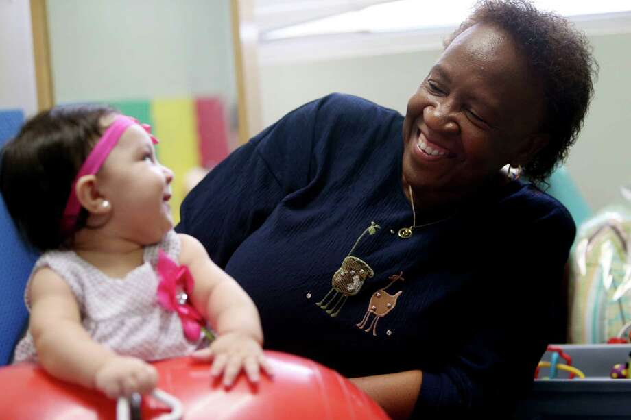 Greta Cherry, a physical therapist, works with Briseida Montemayor, six-months, at the Eater Seals Southeast Outreach Monday, March 14, 2016, in Houston, Texas. Cherry has been a therapist for 43-years with Easter Seals. ( Gary Coronado / Houston Chronicle ) Photo: Gary Coronado, Staff / © 2015 Houston Chronicle