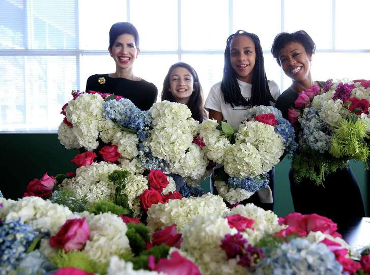 Jordan Fein and Lauren Elie, both 12, and their mothers, Kellie Cohen Fein and Gina Gaston Elie, donated floral arrangements at the Ronald McDonald House Houston.