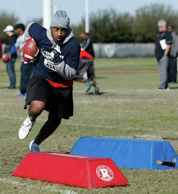 Ashton Turner goes through agility drills during the Senior Showcase at the Houston Texans Methodist Training Center.