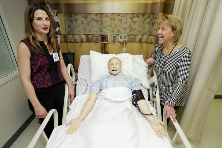 Marie Johnson, left, Memorial Hermann clinical nutrition manager, and Jeanne Piga-Plunkett, head of UTHealth's dietetic internship program, discuss the simulation lab's high-tech mannequin.
