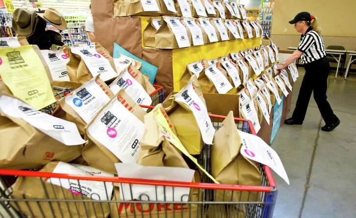 An H-E-B employee sets up meal bags to be donated to the Houston Food Bank.