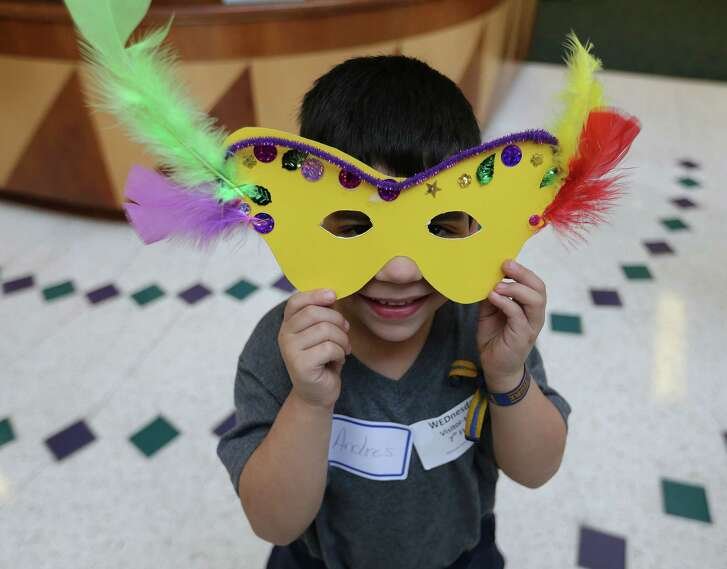 Andres Garcia, 4, of Nuevo Heraldo, Mexico, shows off his Mardis Gras mask he made with Art of Hope at Shriner's Hospital in Houston on Wednesday, Jan. 27, 2016, in Houston. ( Elizabeth Conley / Houston Chronicle )