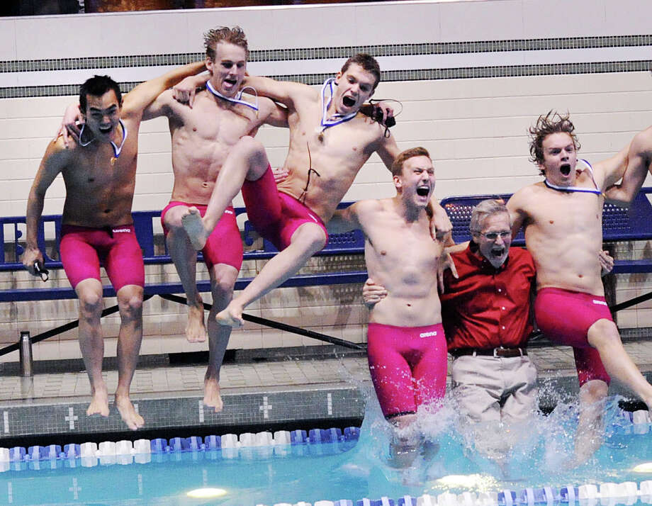 Greenwich swimmers from left, Nicholas Handali, Jack Montesi, Aedan Lewis, Conrad Moss, Greenwich boys swim coach Terry Lowe (red shirt) and Nicholas Heydan jump into the Yale University pool after winning the CIAC State Open swimming championships Saturday at Yale University. Photo: Bob Luckey Jr. / Hearst Connecticut Media / Greenwich Time