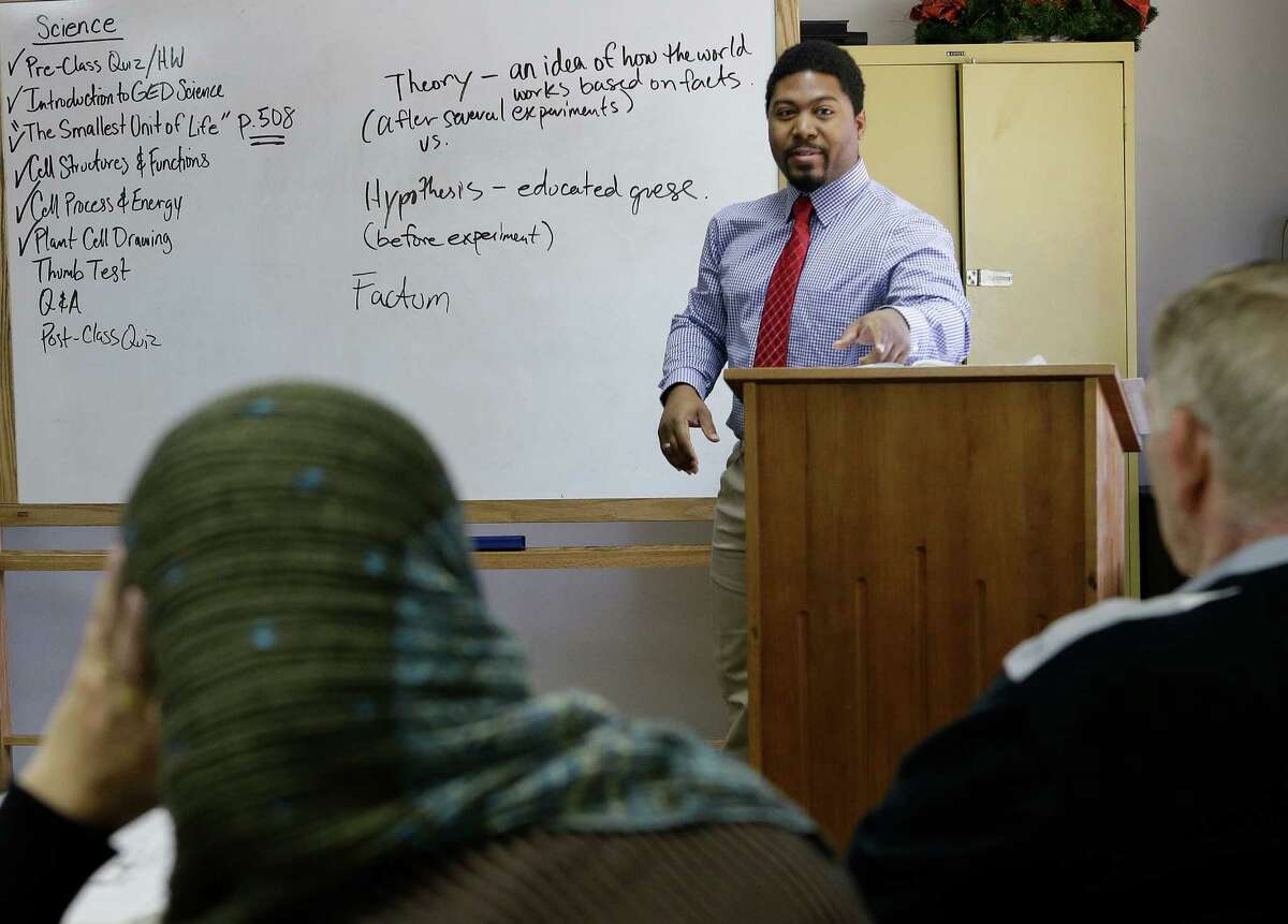 DeAndre Espree-Conaway teaches an Adult GED class at Houston Center for Literacy at the Gethsemane Campus of St. Luke's United Methodist Church, 6856 Bellaire Blvd., Tuesday, Jan. 19, 2016, in Houston. ( Melissa Phillip / Houston Chronicle )
