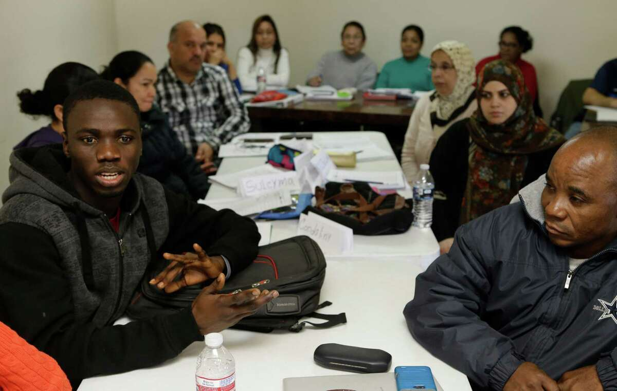 Oumar Kaba, left, from Guinea is shown in the high level ESL class at Houston Center for Literacy at the Gethsemane Campus of St. Luke's United Methodist Church, 6856 Bellaire Blvd., Tuesday, Jan. 19, 2016, in Houston. ( Melissa Phillip / Houston Chronicle )