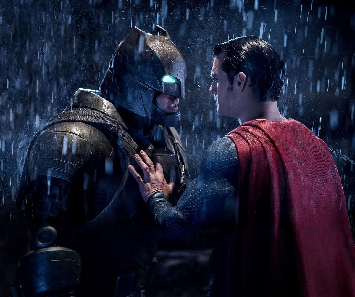 """This image released by Warner Bros. Entertainment shows Ben Affleck as Batman, left, and Henry Cavill as Superman in a scene from, """"Batman V. Superman: Dawn Of Justice."""" (Clay Enos/Warner Bros. Entertainment via AP)"""