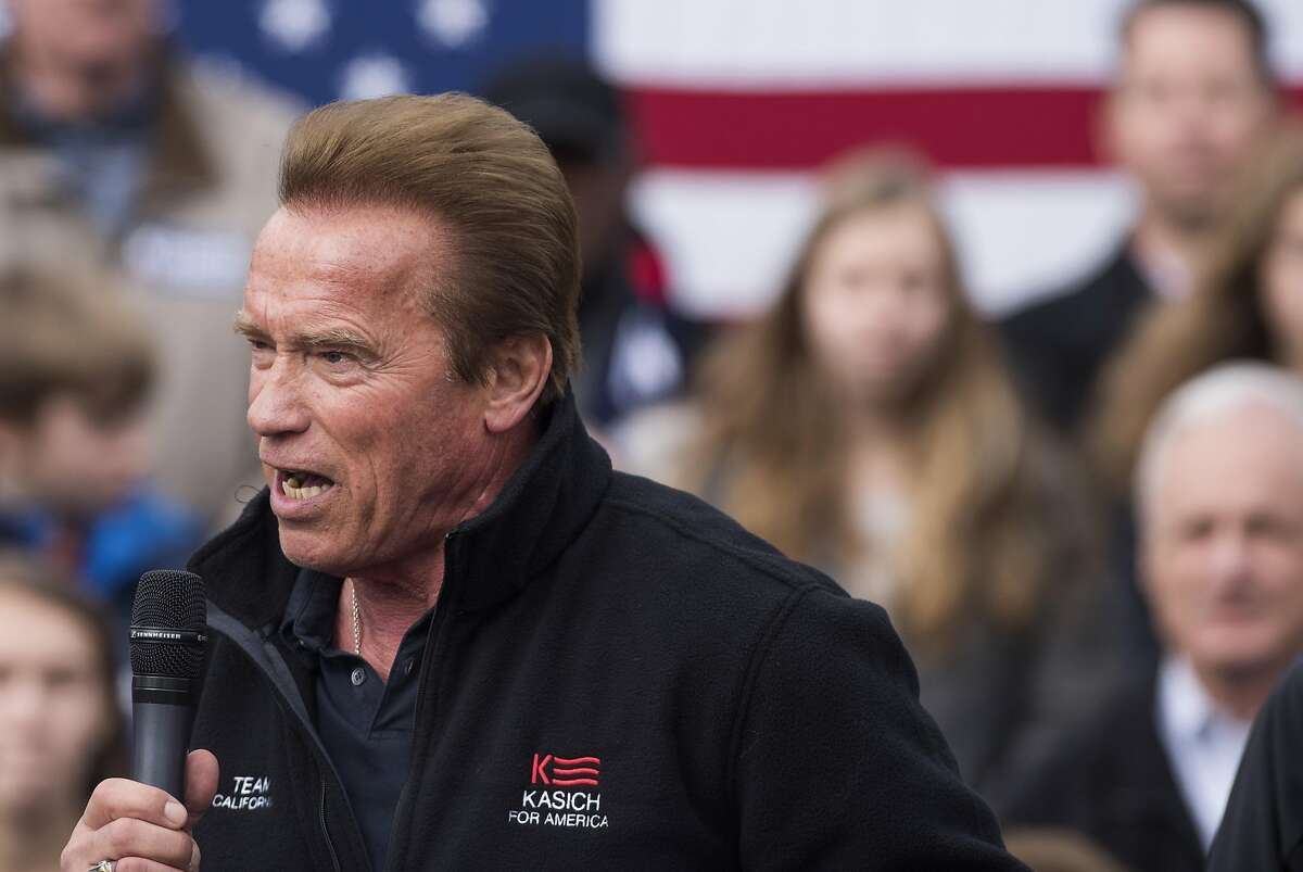 Former California Gov. Arnold Schwarzenegger speaks to a crowd during a campaign rally for Ohio Gov. John Kasich at the Wells Barns at the Franklin Park Conservatory on March 6, 2016, in Columbus, Ohio.
