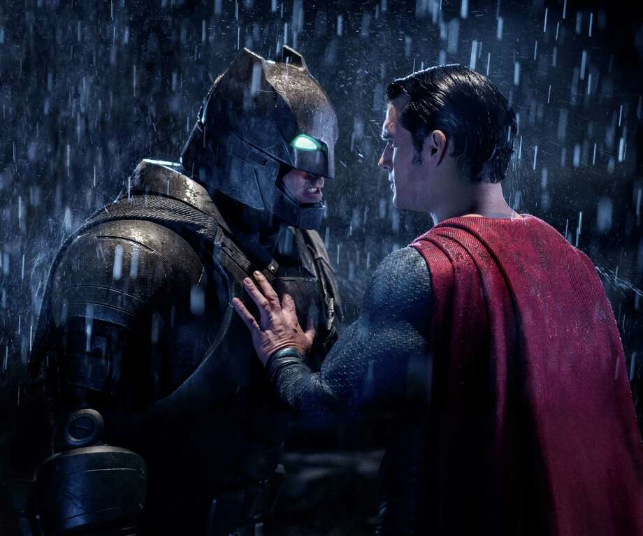 """This image released by Warner Bros. Entertainment shows Ben Affleck as Batman, left, and Henry Cavill as Superman in a scene from, """"Batman V. Superman: Dawn Of Justice."""" (Clay Enos/Warner Bros. Entertainment via AP) Photo: Clay Enos, HONS / AP / Warner Bros. Entertainment"""
