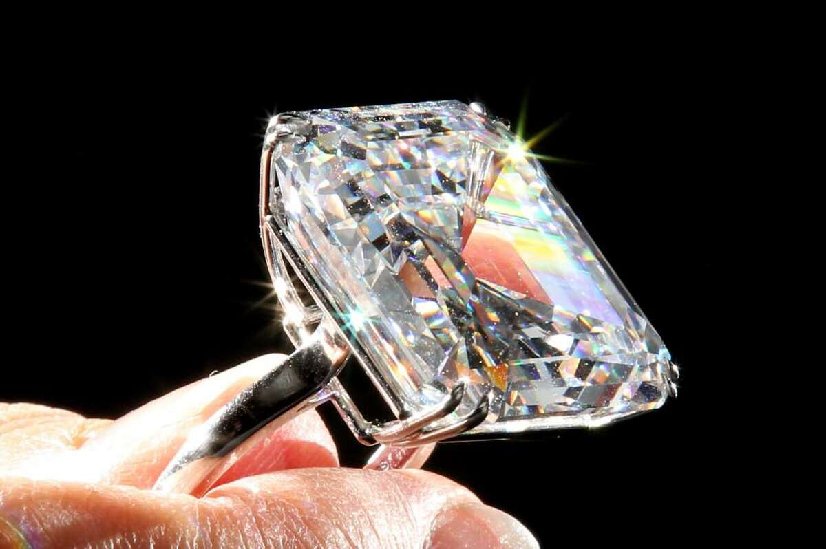 LONDON, ENGLAND - APRIL 12: A Sotheby's employee holds a rare 52.82-carat white diamond ring at Sotheby's auction house on April 12, 2010 in London, England. The ring makes up part of the Geneva Magnificent Jewels Sale which takes place on 11 May, 2010 at Sotheby's in Geneva, and is expected to fetch approximately 7 million USD. (Photo by Dan Kitwood/Getty Images)
