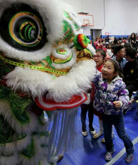 Sara Yu takes part in the Chinese Community Center's Lunar New Year Festival.