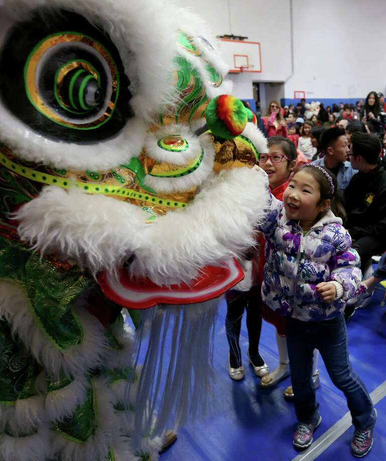 Sara Yu takes part in the Chinese Community Center's Lunar New Year Festival. Photo: Jon Shapley, Staff / © 2015  Houston Chronicle