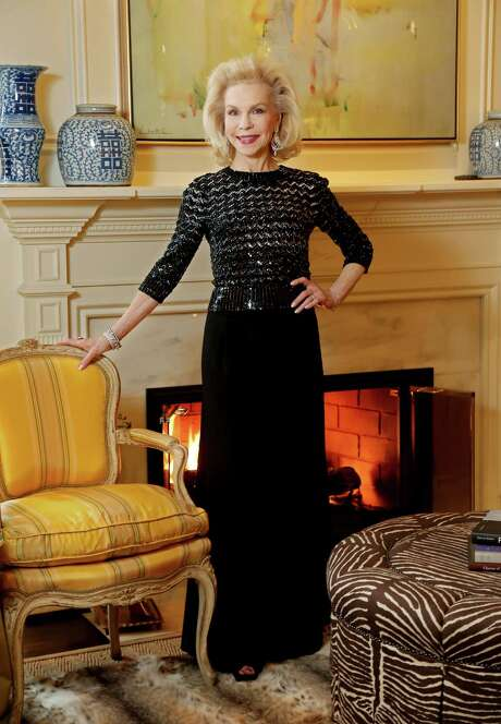 Lynn Wyatt wears a Jenny Packham top and Chanel evening pants at her home in Houston.