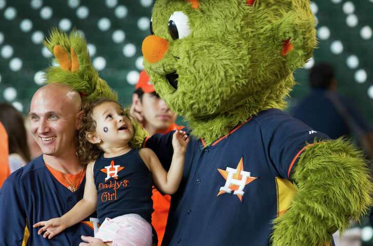 Matt McCurley and daughter Madison meet Houston Astros mascot Orbit at the Astros Foundation's annual charity Picnic in the Park at Minute Maid Park.
