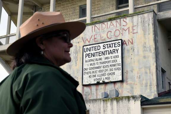 Alex Picket of the National Parks Service is seen in front of fading political slogans left on Alcatraz Island during the Indian Occupation of 1969, in San Francisco, CA Wednesday, March 23, 2015.