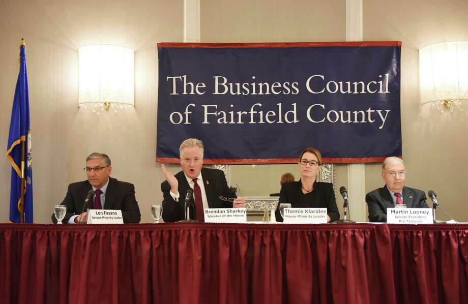 Panelists, from left, Senate Minority Leader Len Fasano (R), Speaker of the House Brendan Sharkey (D), House Republican Leader Themis Klarides, and Senate President Pro Tempore Martin Looney (D) speak at The Business Council of Fairfield County's 2016 Connecticut Legislative Leadership Breakfast at the Crowne Plaza in Stamford, Conn. Wednesday, March 23, 2016. The Congressmen discussed the Connecticut business climate in a panel discussion moderated by BCFC Vice President of Public Policy and Programs Joe McGee. Photo: Tyler Sizemore / Hearst Connecticut Media / Greenwich Time