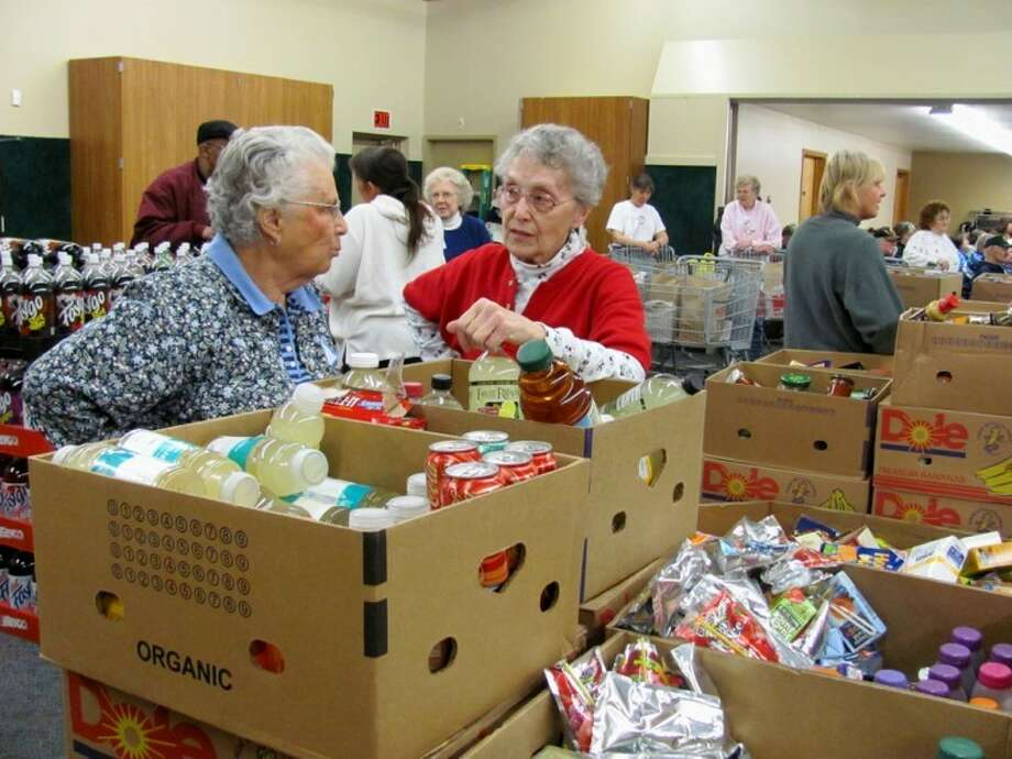 Volunteers prepare for a Midland County Emergency Food Pantry Network mobile food pantry in this Daily News file photo.