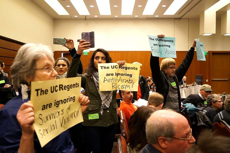 Protesters vent their feelings on a variety of issues during a meeting at UCSF Mission Bay at which a UC regents committee adopted a document that condemns anti-Semitism and urges punishment of bigots who target others. Photo: James Tensuan, Special To The Chronicle