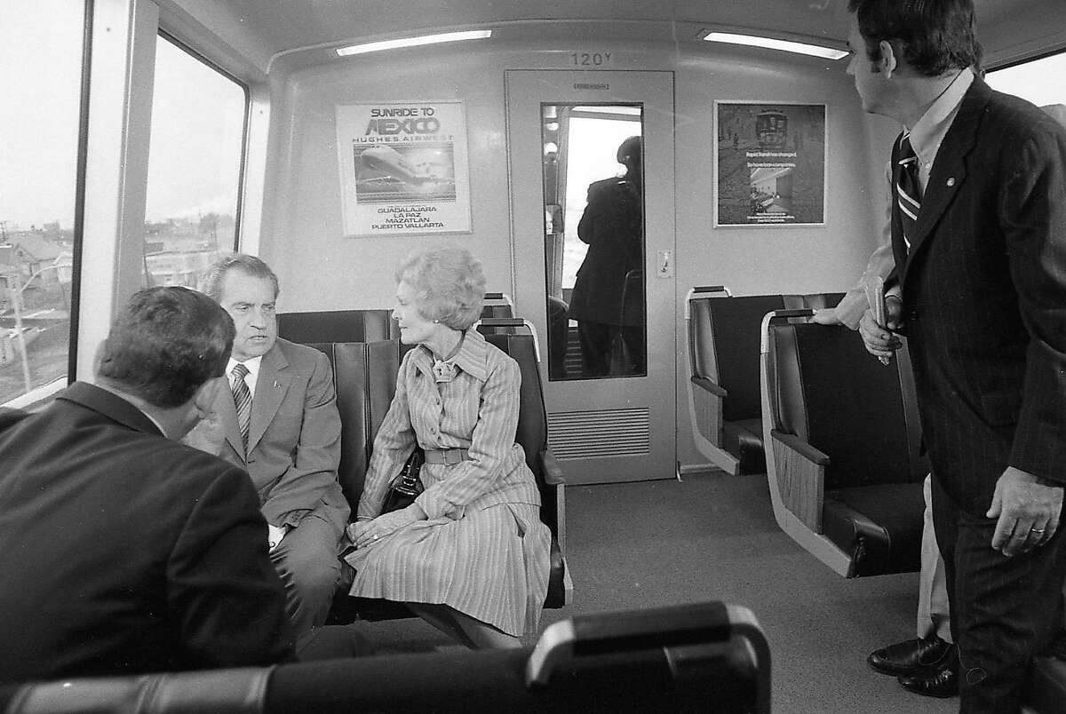 A wider shot of Richard Nixon and his wife Pat during a November 1972 trip on BART.