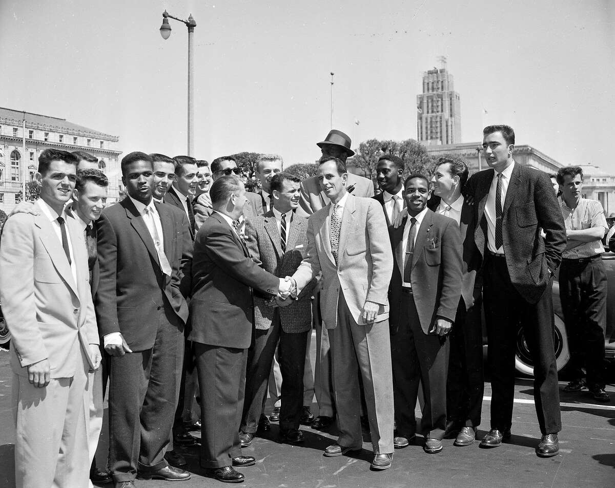 University of San Francisco (USF) basketball team parade through San Francisco after winning NCAA title. Negative date 4/7/1956