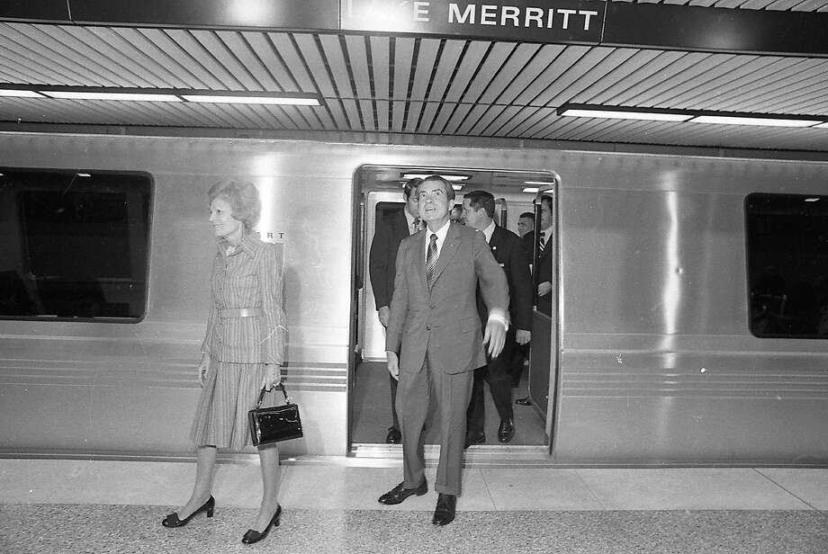 An awed President Richard Nixon, preceded by first lady Pat, steps out of BART onto the Lake Merritt Station platform after a smooth trip from San Leandro Station in in November 1972. Photo: Larry Tiscornia, The Chronicle