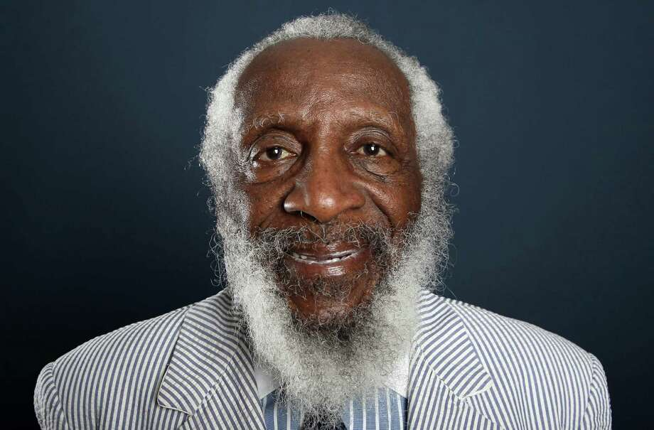 """FILE - In this July 21, 2012 file photo, comedian and activist Dick Gregory, from the upcoming documentary film """"Soul Food Junkies,"""" poses for a portrait during the PBS TCA Press Tour in Beverly Hills, Calif. A play about Gregory will open off-Broadway this spring starring Joe Morton and with an original song by John Legend. """"Turn Me Loose,"""" by Gretchen Law will play the Westside Theatre starting May 3, 2016, under the direction of John Gould Rubin. (Photo by Matt Sayles/Invision/AP, File)  ORG XMIT: CAET505 Photo: Matt Sayles / Invision"""