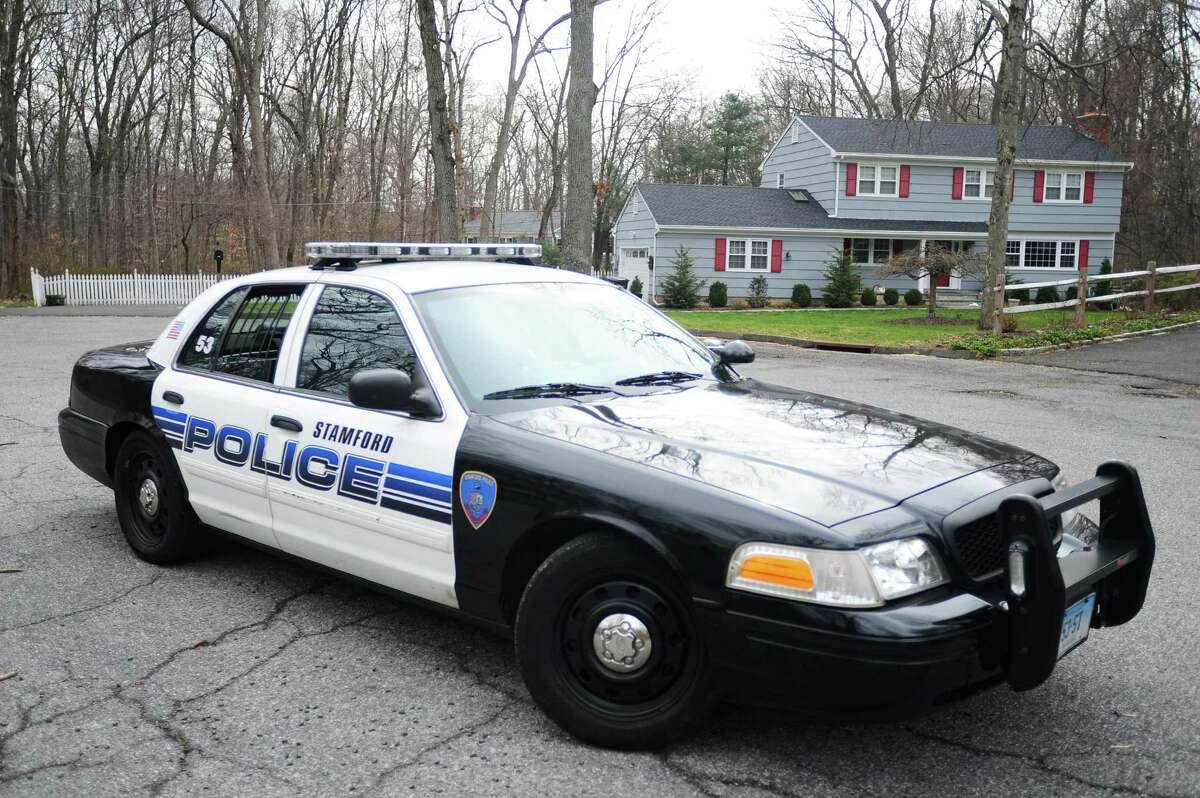 A Stamford police car sits in front of the Pape home, two days after the fatal shooting of 25-year-old Dylan Pape following an hour-long standoff with police.