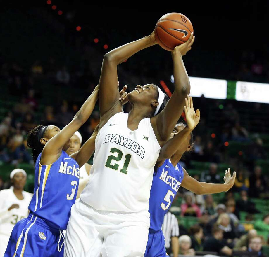 FILE - In this Dec. 13, 2015, file photo, Baylor forward/center Kalani Brown (21) is fouled while shooting past McNeese State guard Jayln Johnson (3), left, and forward Jasmyn Carswell (5), right, in the first half of an NCAA college basketball game, in Waco, Texas. Baylor women have two freshman post players who are having big impacts.  (AP Photo/Rod Aydelotte, File) ORG XMIT: NY165 Photo: Rod Aydelotte / FRE36102AP