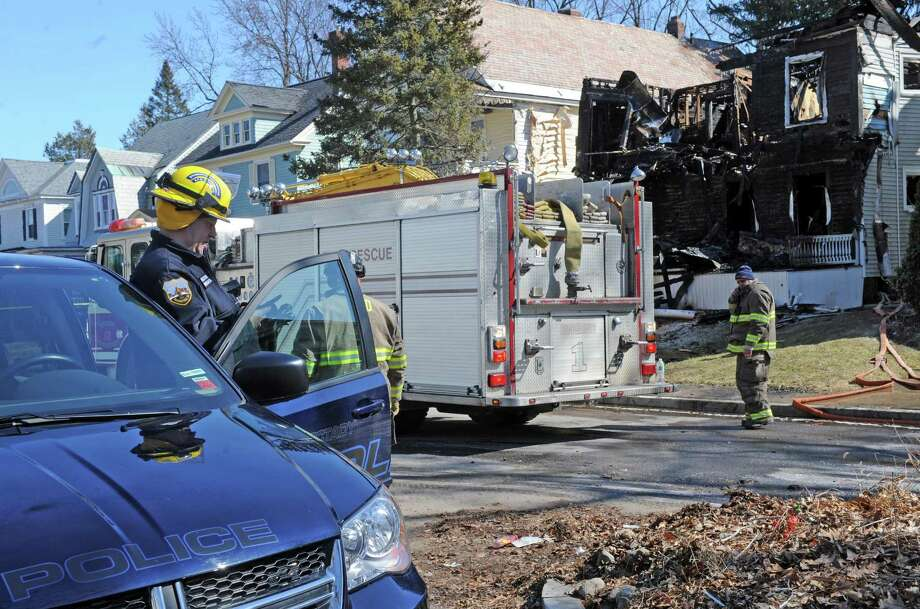 Fire investigators work the scene of a fire at 1052 Parkwood Boulevard on Friday, March 4, 2016, in Schenectady, N.Y. Nearly three weeks after a raging fire destroyed a Parkwood Boulevard home, fire investigators are still awaiting test results of samples from the wall and floor that could yield clues about the cause and origin of the blaze at the residence outside where a man was murdered in 2014. (Michael P. Farrell/Times Union archive) Photo: Michael P. Farrell / 10035723A