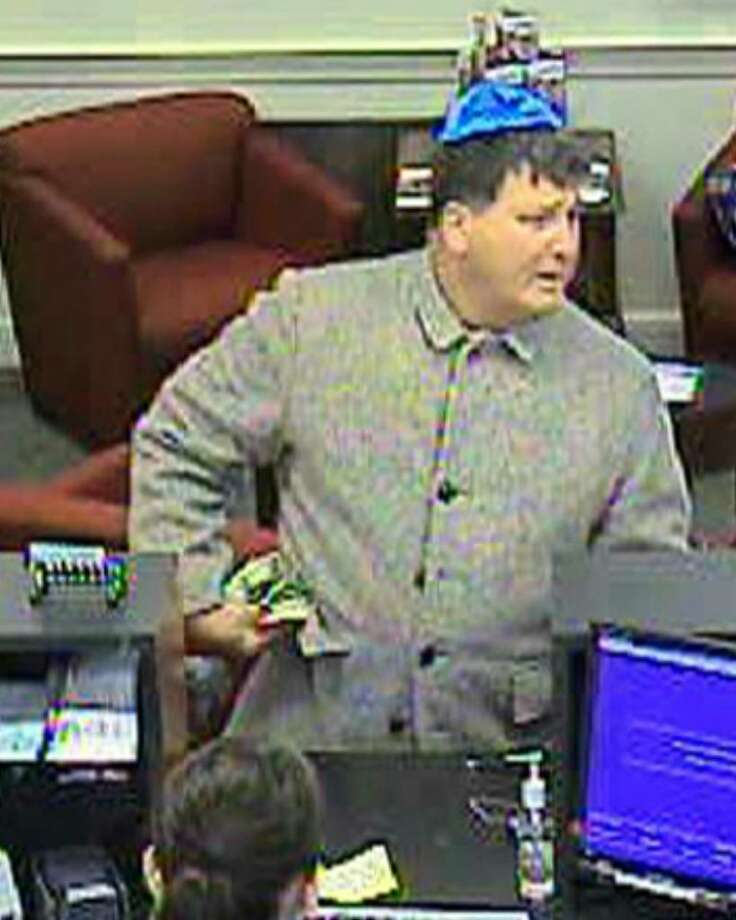 """At approximately 10:30am Monday April, 12, 2010, a white male entered the Bank of America located at 7 Sedgwick Avenue in Darien, Conn. approached a teller and demanded money. No weapon was displayed during the incident. The suspect had graying hair, was wearing a bright blue yarmulke, a grey waist length """"pea coat,"""" and dark pants. He was last seen leaving the establishment on foot. The Darien Police K-9 Unit tracked the suspect to the area of Goodwives Shopping Center where it is possible that the suspect then left the area in a vehicle. If anyone has any information regarding this incident, please call the Darien Police Detective Division at 203-662-5330. Photo: Contributed Photo / Stamford Advocate Contributed"""