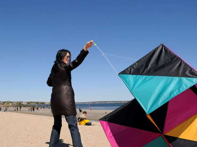 Wenjin Qiu of Greenwich trys in vain to get her box kite into the air during the annual Kite Flying Festival at Greenwich Point, Saturday, Aril 10, 2010. Photo: Bob Luckey / Greenwich Time