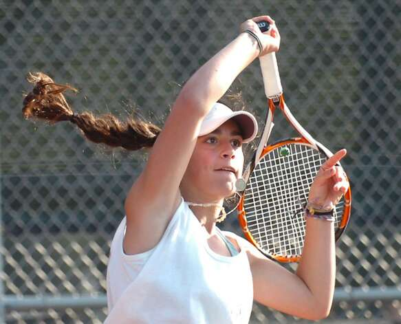 Jen DeLuca of Greenwich High School in action during her match against Christie Schneider of Fairfield Warde High School, April 8, 2010, at GHS. Photo: Bob Luckey / Greenwich Time