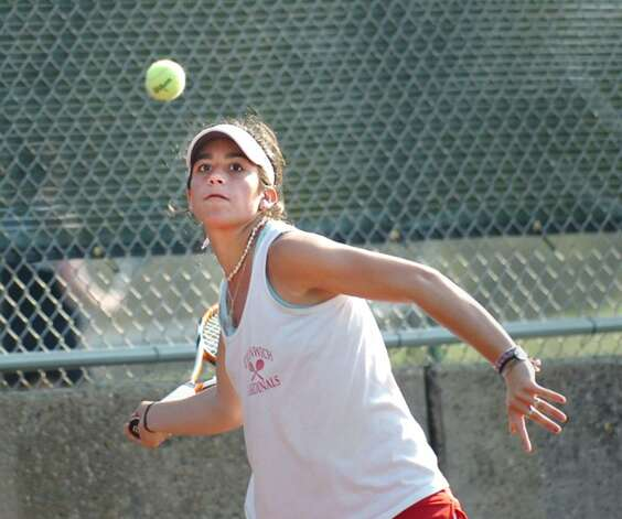 Jen DeLuca of Greenwich High School in action during her match against Fairfield Warde's Christie Schneider, April 8, 2010, at GHS. Photo: Bob Luckey / Greenwich Time