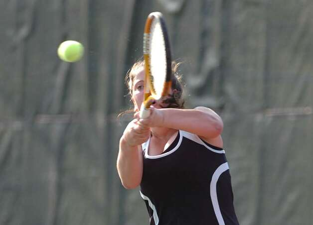 Fairfield Warde's Haley Wolf in action against Danielle Cepelewicz of Greenwich High School, April 8, 2010, at GHS. Photo: Bob Luckey / Greenwich Time