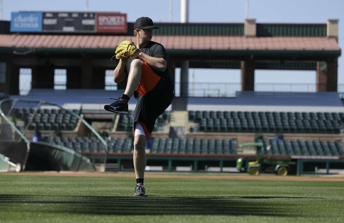 San Francisco Giants pitcher Matt Cain warms up the day before the spring baseball season begins in Scottsdale, Ariz., Wednesday, Feb. 17, 2016. (AP Photo/Chris Carlson)