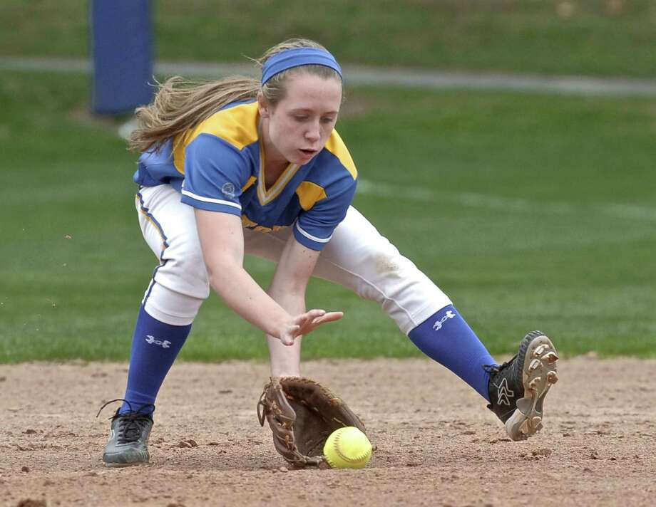 Newtown's Sara Kennedy (5), second base, fields a ground ball before throwing to first for the out during the girls high school softball game between Joel Barlow (Redding) and Newtown high schools, played at Newtown High School, on Wednesday, April22, 2015, in Newtown, Conn. Photo: H John Voorhees III / H John Voorhees III / The News-Times