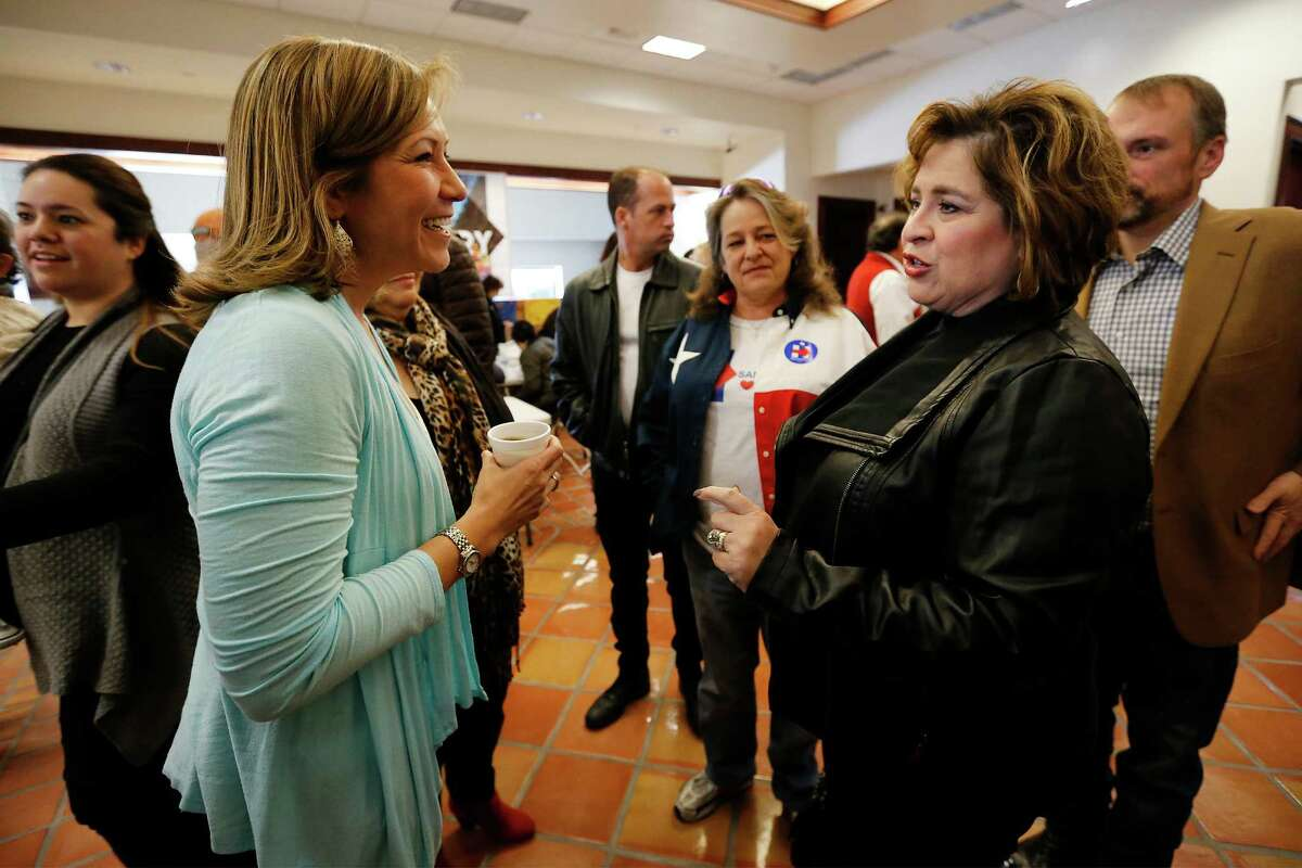 Hillary for America national political director Amanda Renteria (left) and Leticia Van de Putte (right) chat before rallying supporters for Democratic presidential candidate Hillary Clinton for the upcoming March 1 Primary on the Westside on Saturday, Feb. 6, 2016. Congressman Joaquin Castro also joined Van de Putte and Renteria to rally volunteers who signed up for block-walking and phone calls. (Kin Man Hui/San Antonio Express-News)
