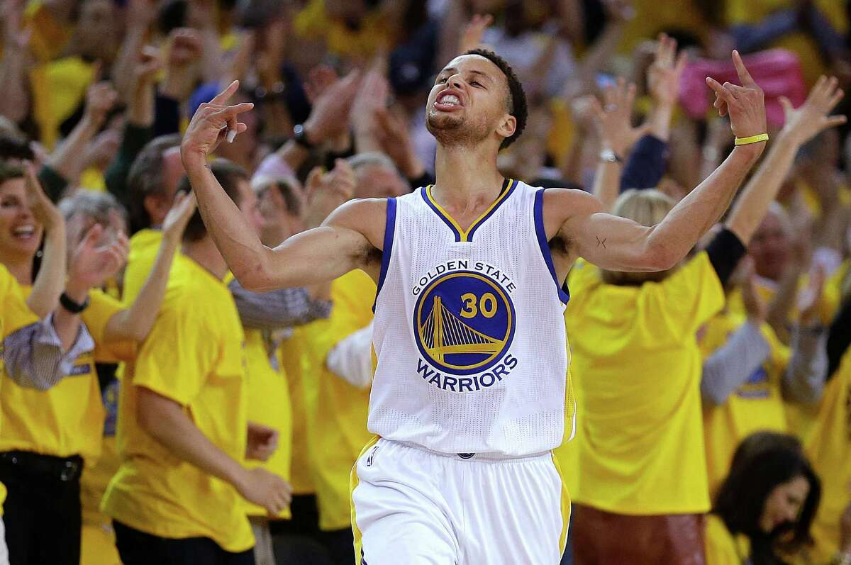 FILE - In this Wednesday, May 13, 2015, file photo, Golden State Warriors guard Stephen Curry reacts after scoring during the first half of Game 5 in a second-round NBA playoff basketball series against the Memphis Grizzlies in Oakland, Calif. Curry has surpassed the Cleveland Cavaliers' LeBron James for the most popular jersey in the NBA. (AP Photo/Ben Margot, File)