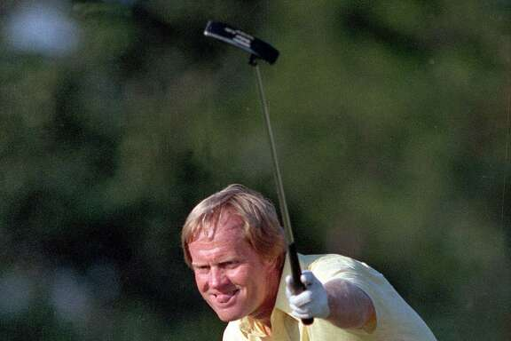 In this April 13, 1986, file photo, Jack Nicklaus watches his shot go for a birdie, giving him the lead and the title, on the 17th at the Masters golf tournament in Augusta, Ga. The Masters will be played for the 75th time this week, a major filled with special moments. Few of them resonate like one 25 years ago, when Nicklaus shot 30 on the back nine to defeatGreg Norman, Tom Kite, Seve Ballesteros and Nick Price, all of whom are in the World Golf Hall of Fame. (AP Photo/Joe Benton, File)
