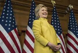 """Hillary Clinton, former Secretary of State and 2016 Democratic presidential candidate, smiles before speaking during an event at Stanford University in Stanford, California, U.S., on Wednesday, March 23, 2016. In the wake of a series of deadly terrorist attacks in Brussels on Tuesday, the U.S. presidential front-runners clashed over interrogation techniques and whether to stop foreign Muslims from entering the country. """"Our country's most experienced and bravest military leaders will tell you that torture is not effective,"""" said Clinton. Photographer: David Paul Morris/Bloomberg *** Local Caption *** Hillary Clinton"""