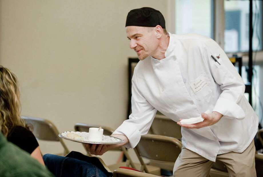 Culinary student Richard Washburn serves hors d'oeuvres at the Community Culinary School of Northwestern Connecticut gala at St. John's Church in New Milford March 19. Photo: Scott Mullin / For The / The News-Times Freelance