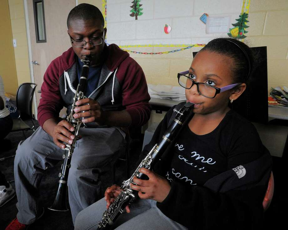 Colin Walters, an instructor with Project Music, works with Kassidy Taylor-Moise as she learns the clarinet at the Addison Community Center in Stamford. Photo: Matthew Brown / Hearst Connecticut Media / Stamford Advocate