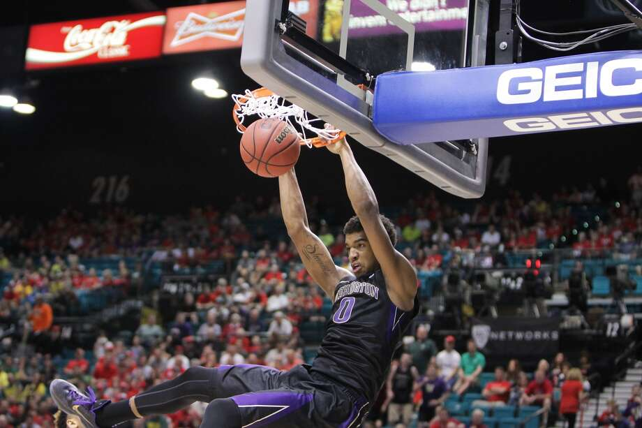 LAS VEGAS, NV - MARCH 10: Marquese Chriss #0 of the Washington Huskies dunks the ball for two against the Oregon Ducks during a quarterfinal game of the Pac-12 Basketball Tournament at MGM Grand Garden Arena on March 10, 2016 in Las Vegas, Nevada. (Photo by Leon Bennett/Getty Images)