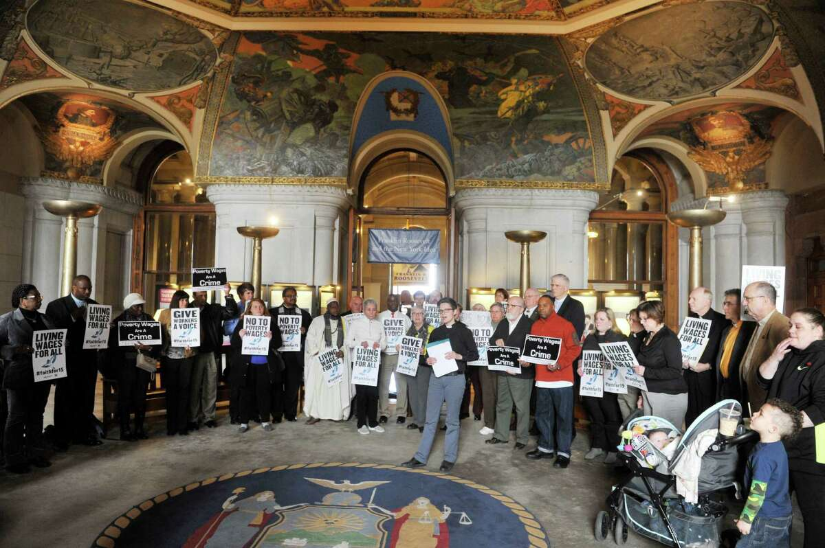 Reverend Emily McNeil with the New York State Labor Religion Coalition addresses those gathered as a coalition of faith groups held a rally calling on legislators to pass an increase in the minimum wage to $15 at the Capitol on Monday, March 21, 2016 in Albany, N.Y. (Paul Buckowski / Times Union)